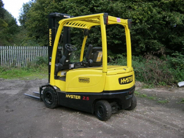 image of a yellow forklift outside